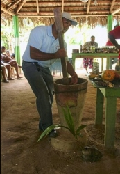 Traditional way of breaking Cacao