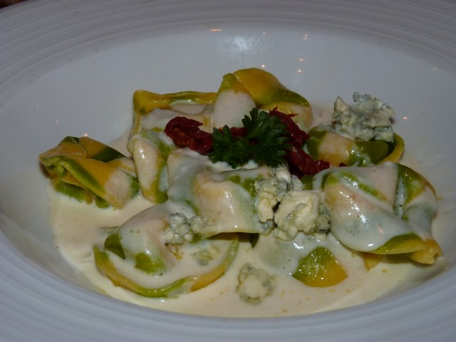 Cheese tortellini topped with blue cheese